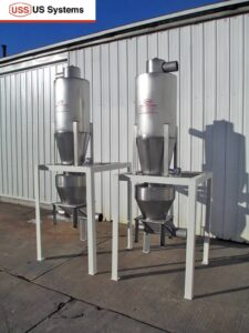 US Systems Cyclone Separators with a Blow-Through Adapter for use with a rotary airlock at a carpet mill in Georgia.