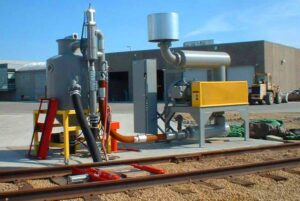 A pneumatic conveying system built by United States Systems, Inc. for unloading cement from railcars.